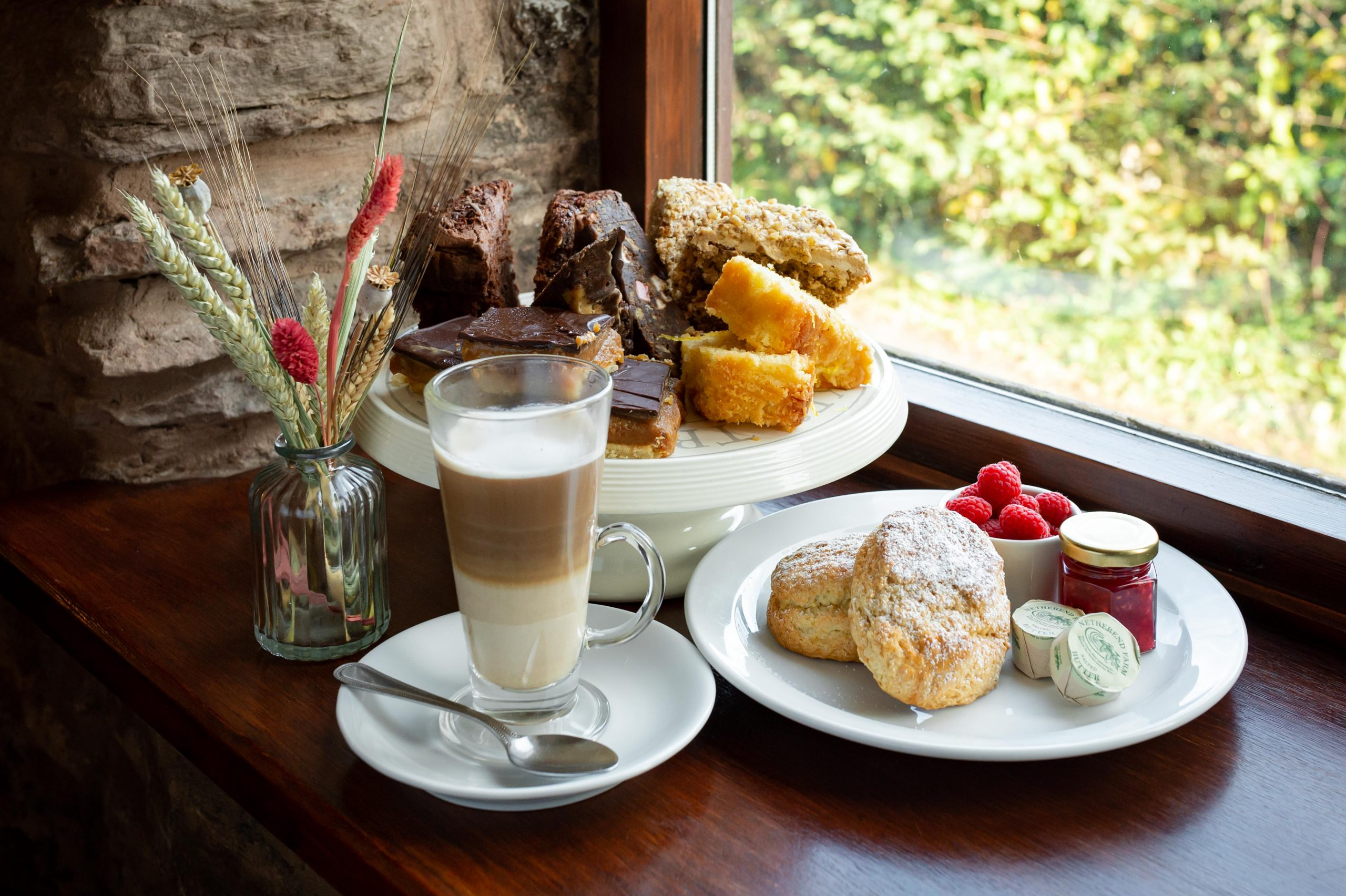 Cakes and scones on a window sill