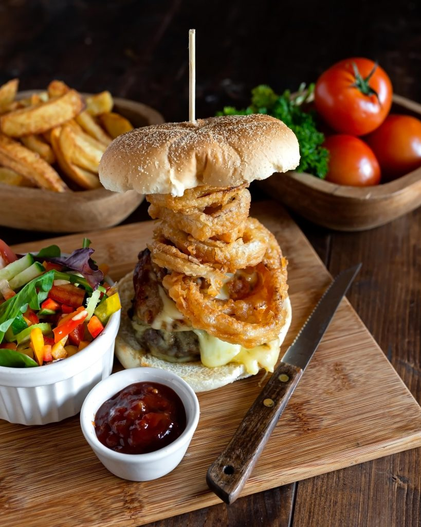 Homemade Herefordshire Beef Burger with crispy onion rings